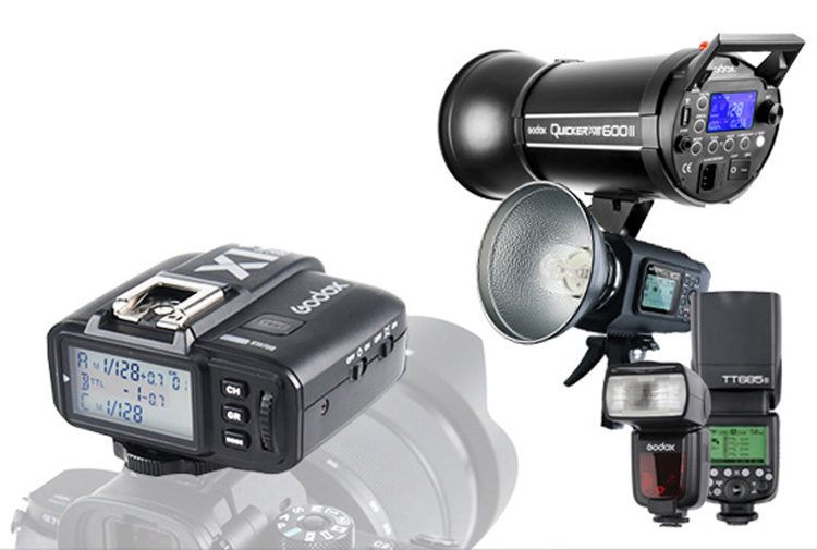 a godox remote trigger gadet and many different types of flashes