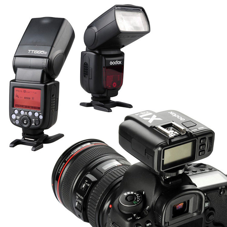 camera with remote trigger mounted on it with two off camera flashes pictured.