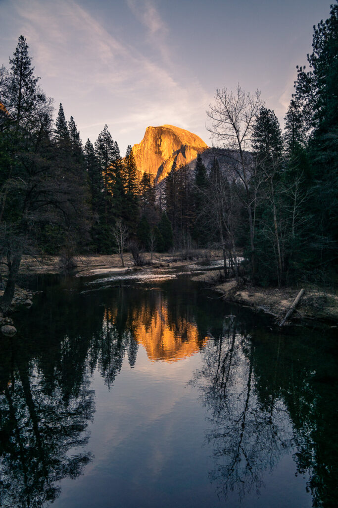 Half dome at sunset reflected in the lake and shot in portrait orientation (vertical)