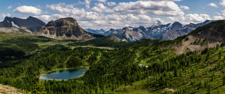 Panormaic photo of Mt Assiniboine mountain range makes for very creative mountain photography
