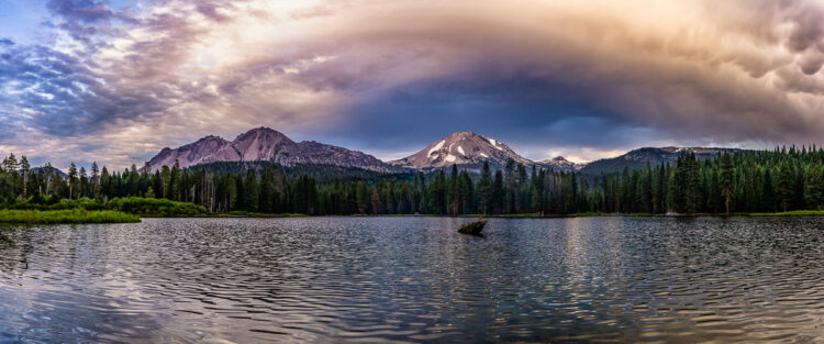 panoramic photo of a storm cloud over mount lassen for a creative mountain photo