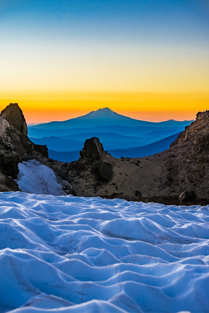 vertical photo of mountains and ice during golden hour sunset for a very creative mountain photography
