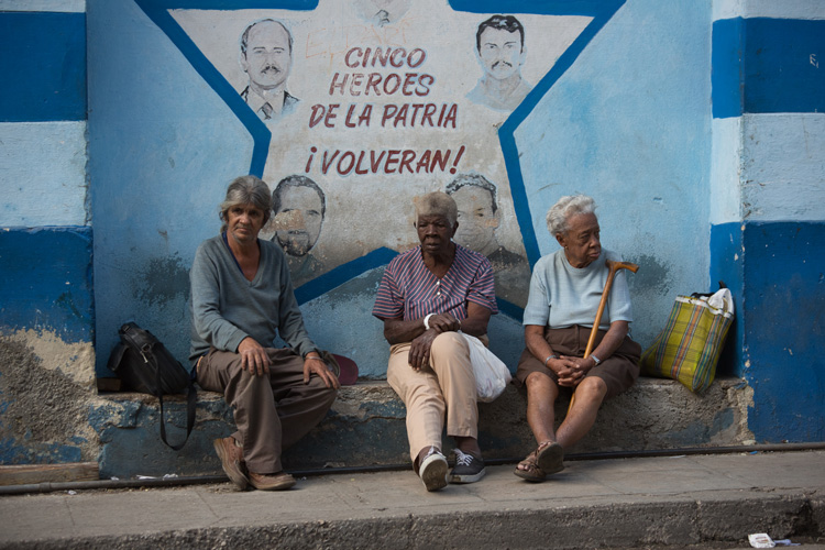 photography challenge for photo editing before photo of Havana cuba street scene of 3 people sitting on a bench