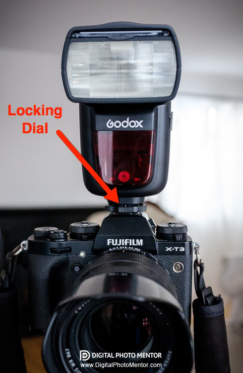 Attach flash to camera hot shoe and lock it in place with locking dial to secure it