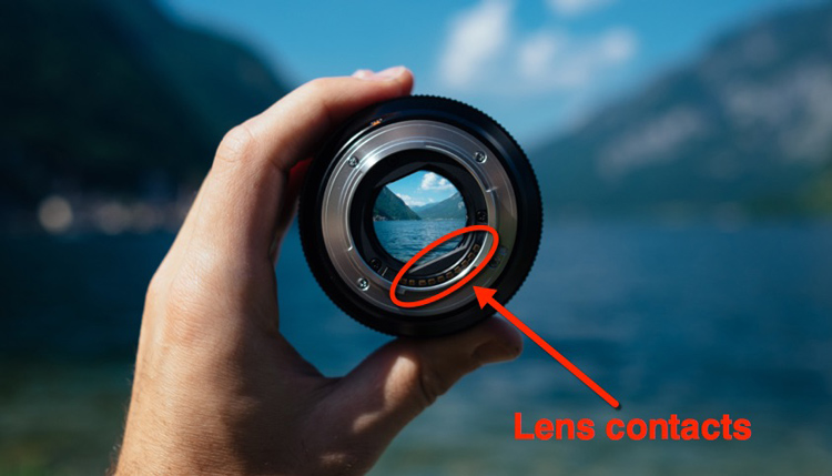 Camera lens showing the lens contacts where it connects and communicates with the camera
