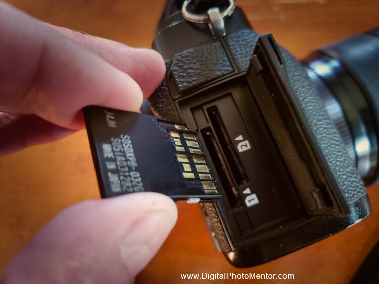insert the memory card into the camera slot carefully and slowly with the pins lined up correctly