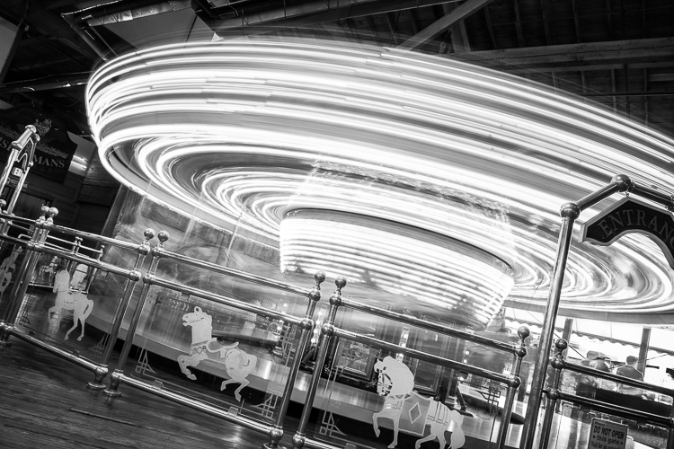 black and white image of a carousel spinning