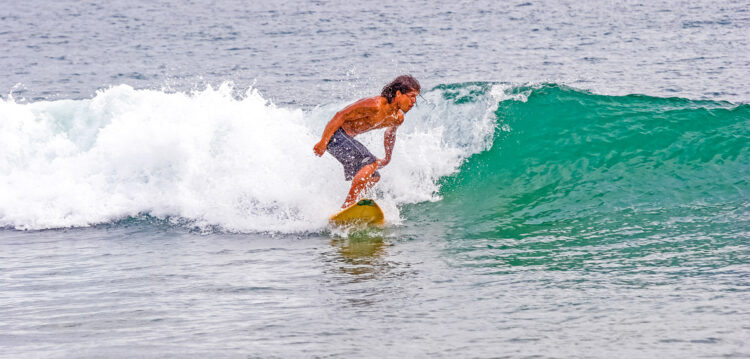 TAMARINDO, COSTA RICA - June 22, 2018: Tamarindo, on the west coast of Coast Rica, has become a mecca for surfers. Even though the population is only a few thousand, the city caters to the surfers.
