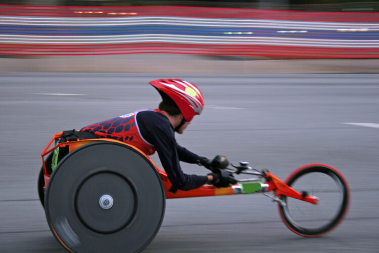 Competitor in wheelchair road race