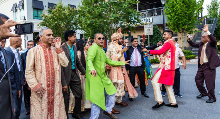 ATLANTA, GEORGIA - August 19, 2018: Indian weddings last an average of 3 days. Part of the ceremony is the baraat, or groom's procession, where guests dance to the beat of a dhol, an Indian drum.n, where guests dance to the beat of a dhol, an Indian drum.