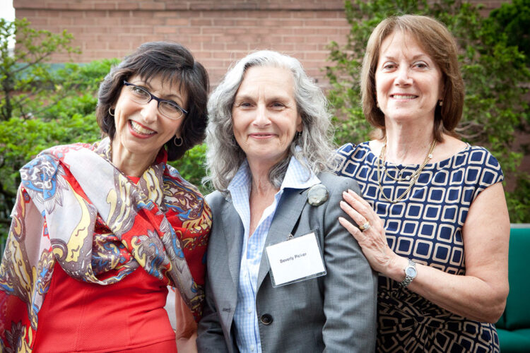 small group photo of three ladies at a corporate event