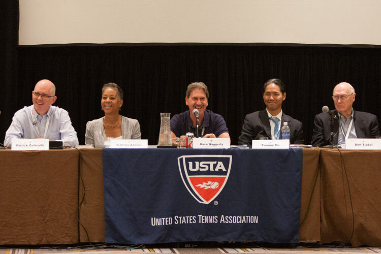 event panel of experts photographed at the right moment capturing smiles and laughter