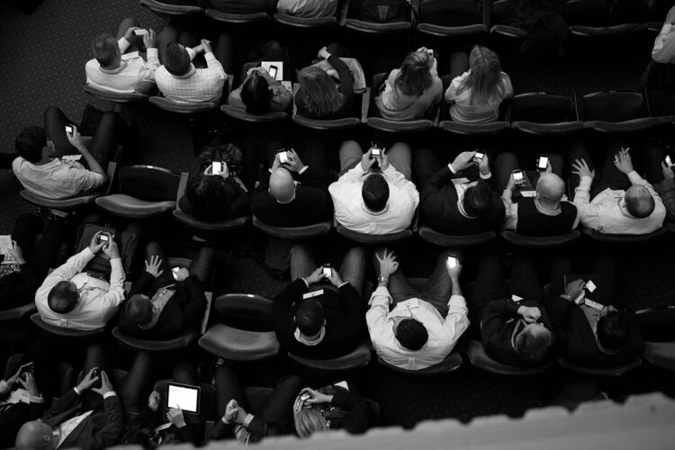 participants sitting in event seats photographed from above