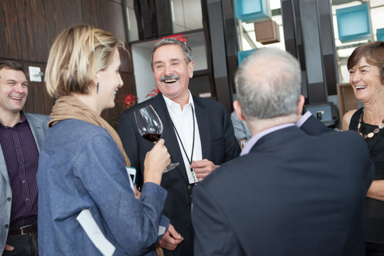 a relaxed social moment at a corporate event caught by the photographer