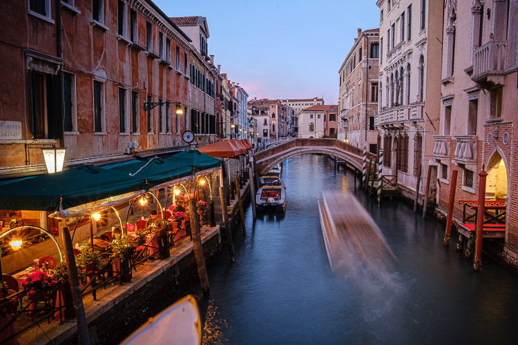 boat in the venice canal at night
