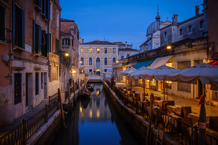 venice at night showing calm water on the canal