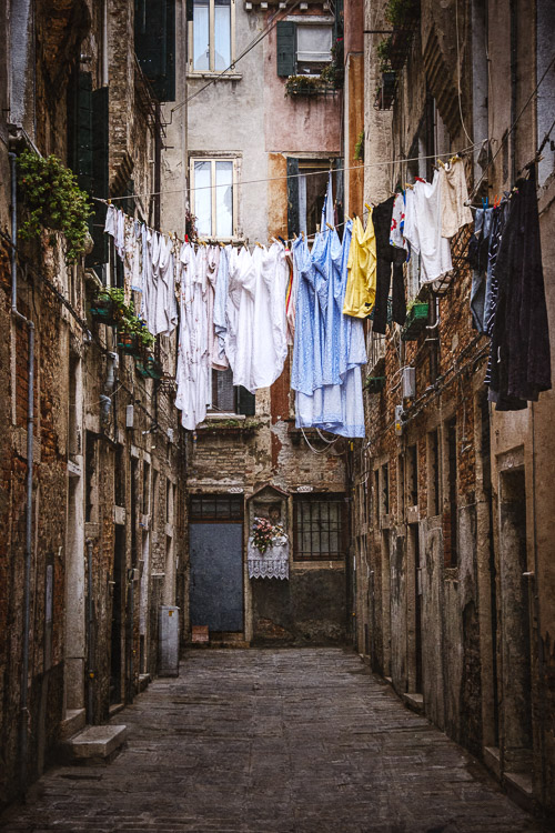 Laundry hanging between buildings in Venice