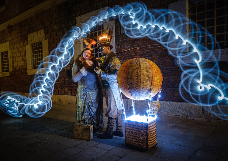 First light painting attempt with models at night showing a blue spiral effect around them