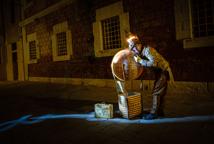 night photography light painting using a flashlight for the effect at Venice Carnival