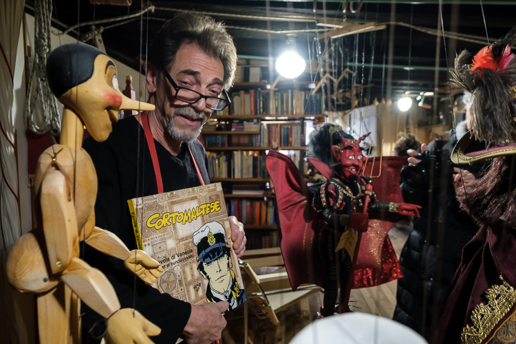 Puppet maker Roberto Comin with his puppets in his shop
