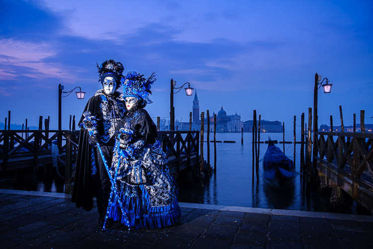 off camera flash used in this photo of Venice carnival costumed characters and lamps made to look lit with photo editing software Lightroom