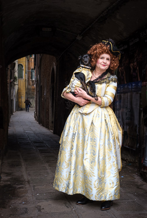 Dog and owner in historical costumes on the streets of Venice