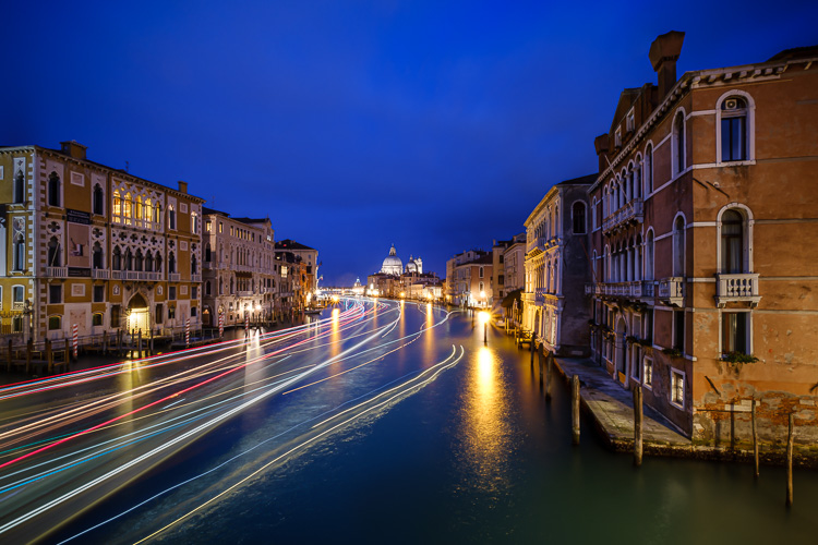 composite photo of boat light trails in a canal in venice italy combined using Photoshop