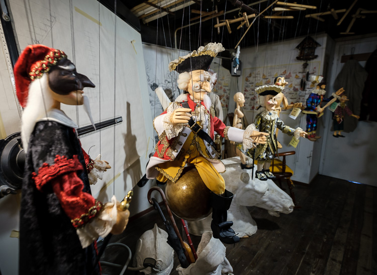 a collection of puppets on display at the puppet maker shop in Venice