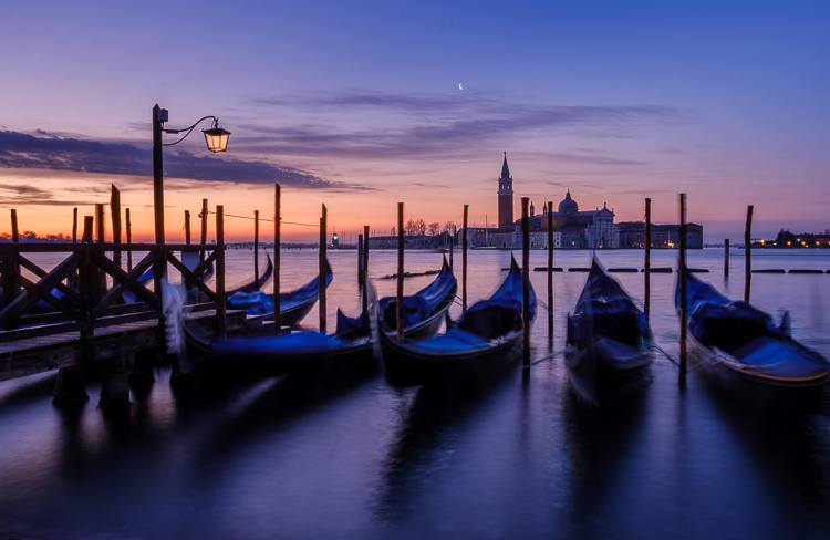 iconic photo of venice with gondolas floating in the water with St. George's Cathedral in the distance