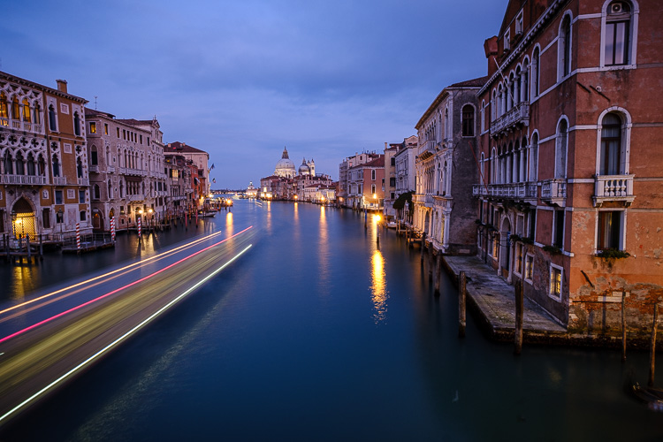 boat light trails at night in the venice canal