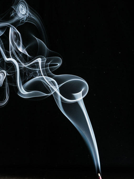 disturbing the air with your hand results in a more creative photo of the smoke