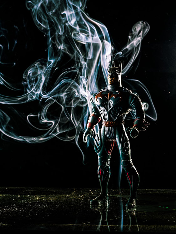 batman action figure enhanced with background smoke trails for a very creative photo