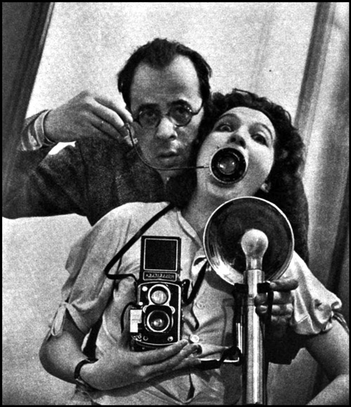 self portrait of Philippe and Yvonne Halsman in a mirror showing camera and flash