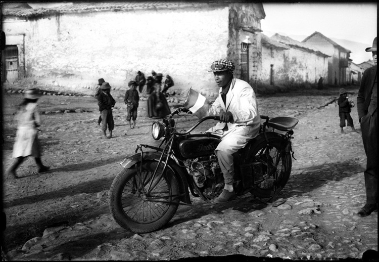 old photo of man on a motorcycle in Cuzco Peru by Martin Chambi