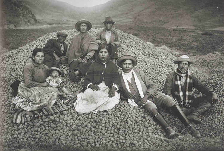 A typical scene seen in Peru, of a family of potato famers with their harvest taken by Martin Chambi