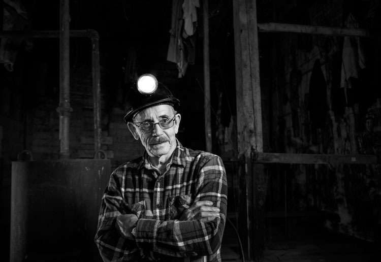 luminar split toning example before photo of a coal miner