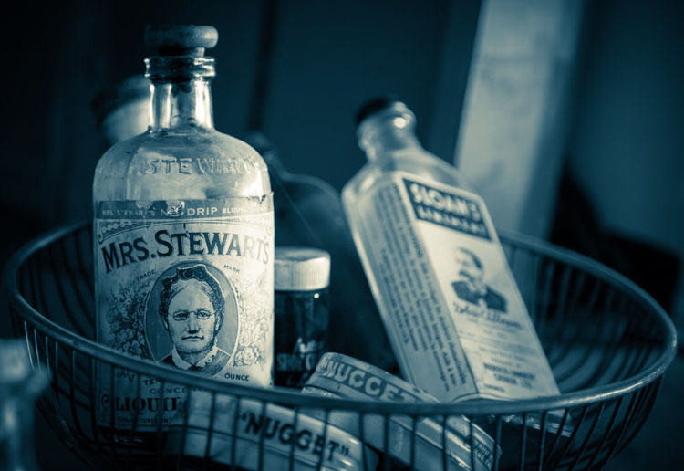 antique bottles with duotone applied using Luminar