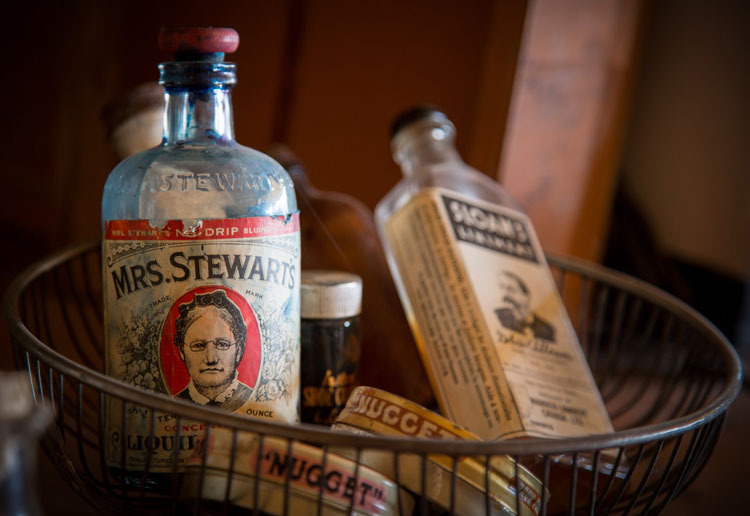 split toning example photo of antique bottles in a basket before photo