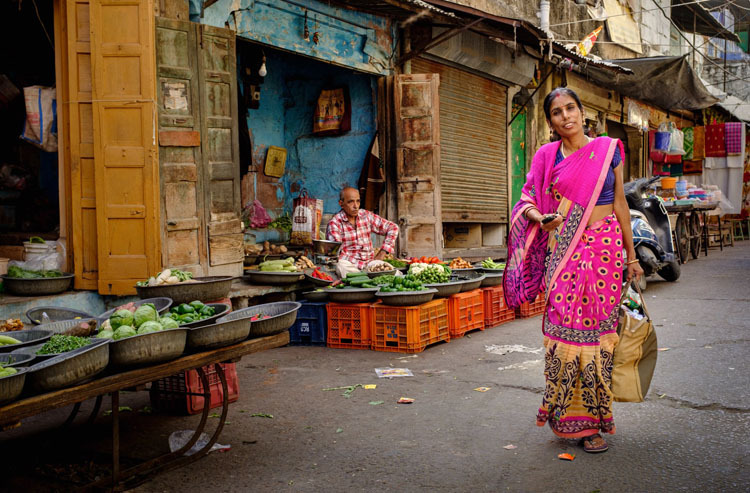 Split toning example of a woman on a street in India before photo