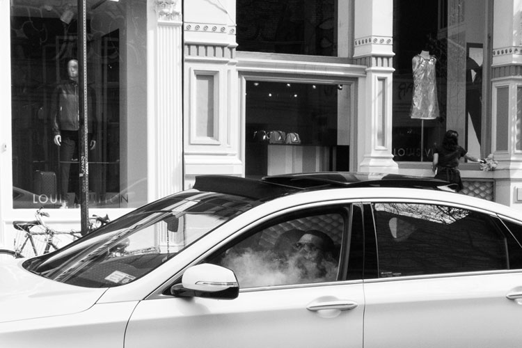 Man in car converted to black and white and with cropping applied